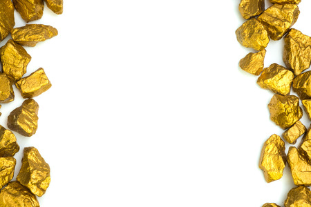 A pile of gold nuggets or gold ore on white background, precious stone or lump of golden stone, financial and business concept idea. Imagens
