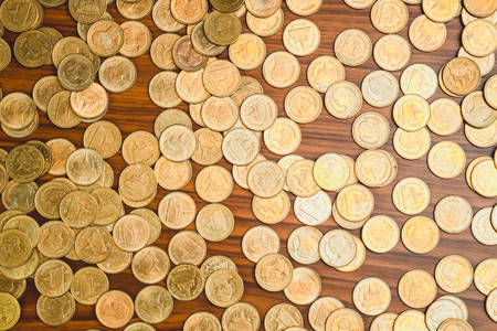 Stack of coin on wooden working table, business and finance concept idea.