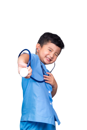 Smiling Asian Thai kid in blue medical uniform holding stethoscope isolated on white, healthy concept idea. clipping path.