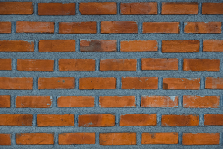 Red brick wall fragment background, texture. or brick layer building.