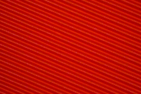 Red corrugated paper texture, use for background. vivid colour with copy space for add text or object.