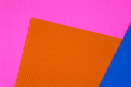 Multi coloured corrugated paper texture, use for background. vivid colour with copy space for add text or object.