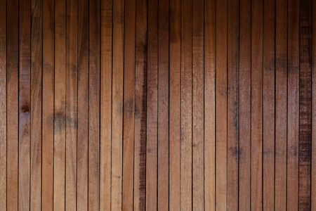 Raw wood, wooden slatted fence or lath wall background texture