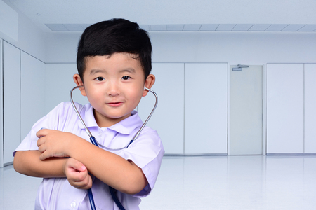 Asian Thai kid with medical stethoscope looking at camera, healthy concept idea. Imagens