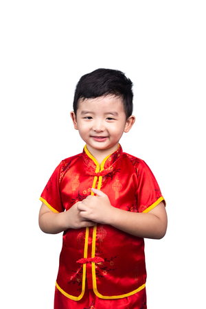 Chinese New Year Concept, Cute Asian boy in red traditional Chinese suit isolated on white background with clipping path. Zdjęcie Seryjne