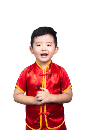 Chinese New Year Concept, Cute Asian boy in red traditional Chinese suit isolated on white background with clipping path. 版權商用圖片