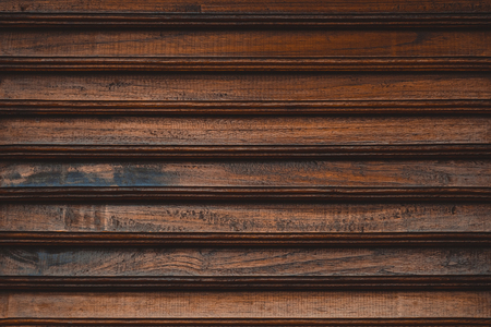 Wooden slatted fence or lath front showcase cabinet or wardrobe, frame door and drawers made from dark wood, background and texture, interior design. texture.