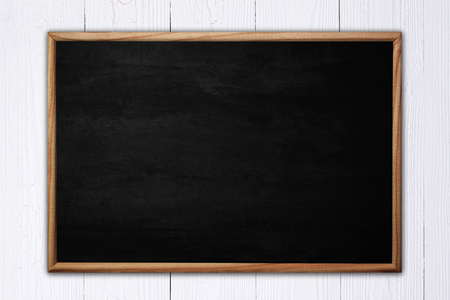 Abstract blackboard or chalkboard with frame on wooden background. empty space for add text. Stock Photo
