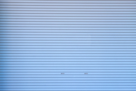 Metal roller shutter door or gate wall closed background and texture. Imagens