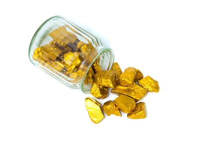 Gold nuggets, gold ore , precious stone or lump of golden stone and glass jar isolated on white background.