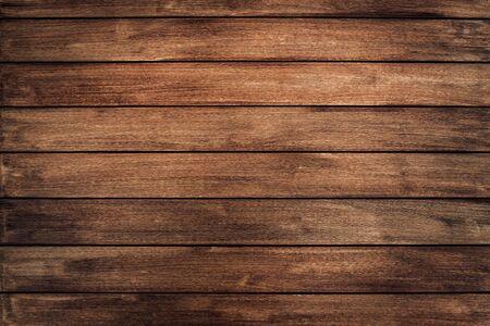 Ciemnobrązowa tekstura drewna z naturalnym wzorem w paski na tle, drewniana powierzchnia do dodawania tekstu lub dekoracji projektowej