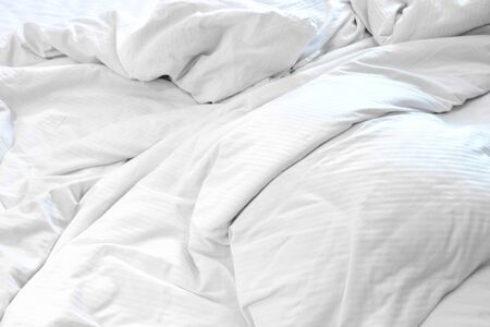 White delicate soft background of fabric or bedding sheet, background.