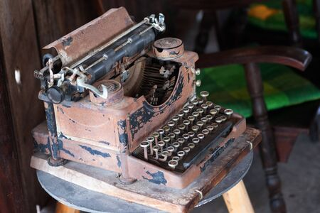 Old vintage rusty typewriter, classic office equipment.
