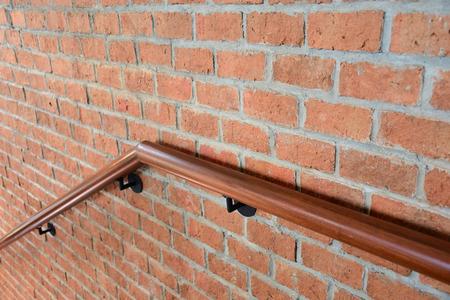 railing: Wooden railing to walk