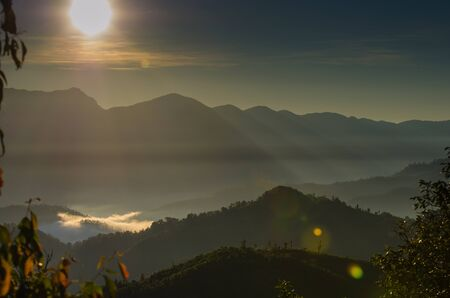 A view from mountains to the valley with sunrise