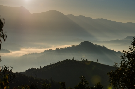 A view from mountains to the valley with sunrise and smog photo