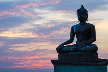 Buddha statue with sunset