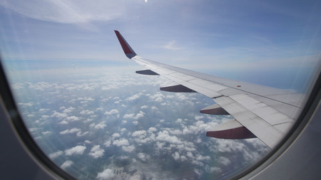 morning flight on cloud and blue sky, amazing view from the window plane,view from the window plane with ocen and blue sky Stock Photo