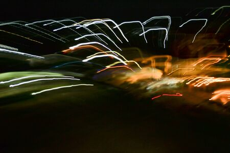 Light neon abstract painting photography - fairy lights in swirl and waves pattern, ripples and loops, striped lines in motion - abstract concept, photo effect - long exposure Stock Photo