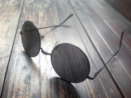 sunglasses on wood background
