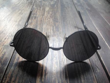 Sunglasses on wood background Stock Photo