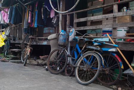 bikes near old wood house