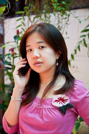 young girl talk on a cellular telephone  photo