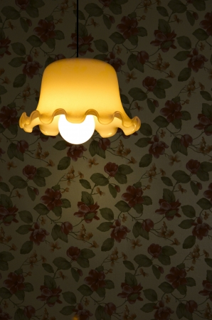 yellow lamp with red flower wallpaper photo