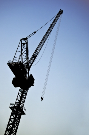 silhouette crane with blue sky photo