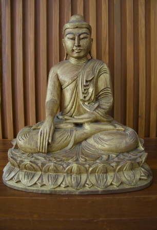 wooden budha on wood table photo