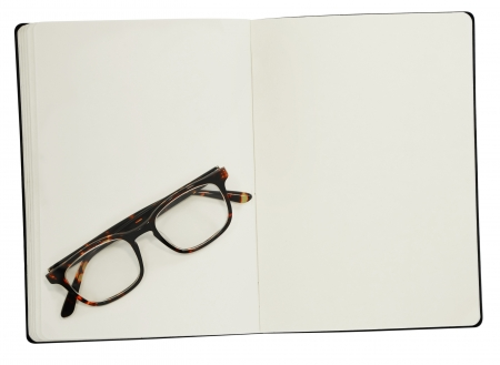 open plan: glasses on the open book  Isolated on white