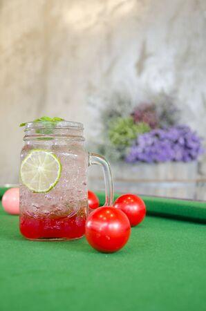 snooker table: Strawberry Italian soda on the snooker table Stock Photo