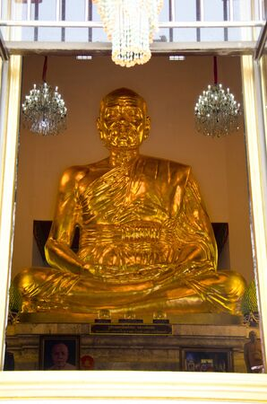sod: Big golden figure of Phra Mongkol Theb Muni (Luang Poh Wat Pak Num) at Chantharangsi Temple, Ang Thong, Thailand. The shrine hall is home to Luang Poh Sod, a metal Buddha image, the largest of its kind in the world, which was constructed in 1996.