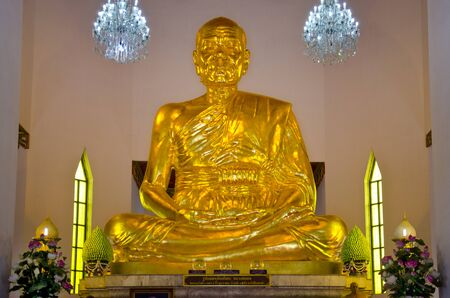 ang thong: Big golden figure of Phra Mongkol Theb Muni (Luang Poh Wat Pak Num) at Chantharangsi Temple, Ang Thong, Thailand. The shrine hall is home to Luang Poh Sod, a metal Buddha image, the largest of its kind in the world, which was constructed in 1996.