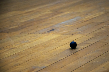 squash ball on the wood floor