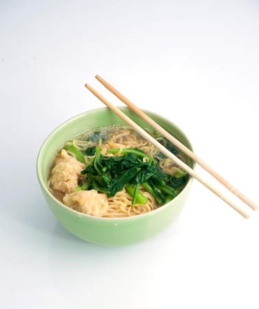 eating noodles: noodle soup in green bowl and chopstick Stock Photo