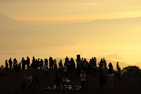 people waiting for sunrise over the hill photo