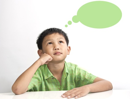 learning language: A boy thinking on white table