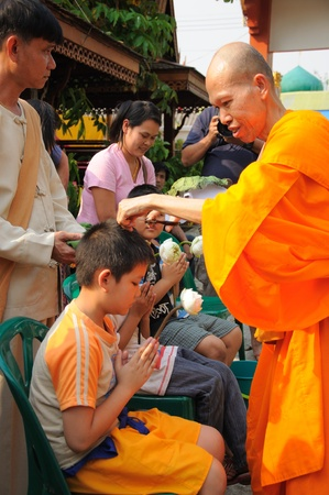 The monk cuts boys hair during Poi Sang Long  festival in April, Ceremony of boys becomes to be novice monk,  during in parade around Mae hong son town. Thailand.