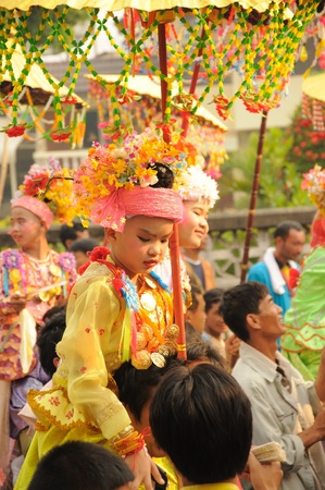 poi: A boy in Poi Sang Long, festival in April, Ceremony of boys becomes to be novice monk,  during in parade around Mae hong son town.