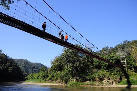 rope bridge: People walk across the rope bridge, north Thailand shot2 Stock Photo