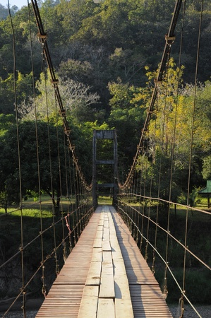 rope bridge: The trial on the Rope bridge across the river to the jungle, North Thailand Stock Photo