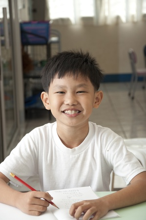 The Asian boy smile in classroom photo
