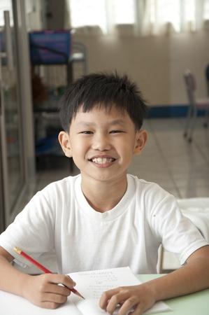 asian boy: The Asian boy smile in classroom Stock Photo