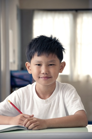 Asian kid in classroom Stock Photo - 12306421