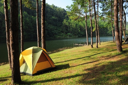 Camping tents by the river photo