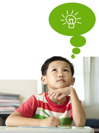 asian kid: The Asian boy thinking in classroom.  Stock Photo