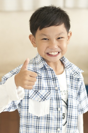 thumps up: Smile kid thumps up Stock Photo