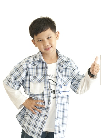 Asian boy thumps up on white background