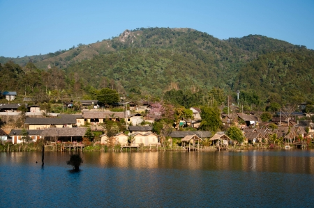 Chinese hill village by the lake, north Thailand photo